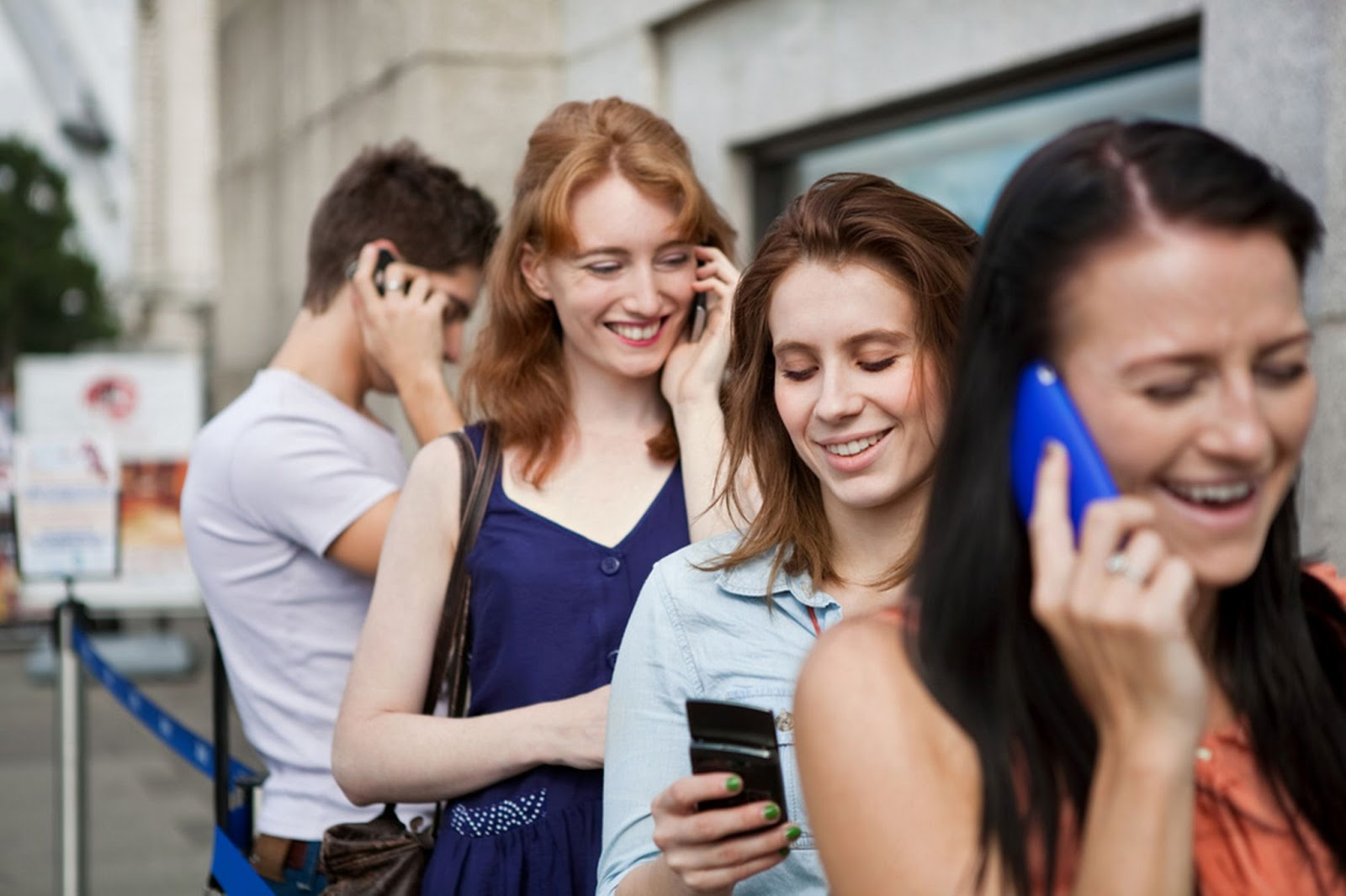 Young+men+and+women+using+mobile+phones